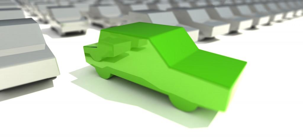 grøn bil foran grå biler